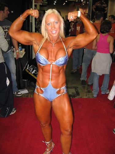 Ruthie Luchessi Shows Biceps And Tanned Buffed Body