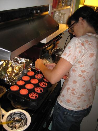 making ladybug cupcakes