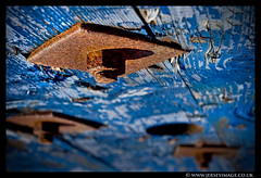 'Out of the Blue' (jerseyimage) Tags: wood blue colour texture 50mm rust paint bokeh painted 14 explore bolt nut flaking cabledrum