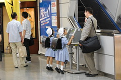 Calling Home. (Mszczuj) Tags: school girls boy boys students girl japan train subway children japanese tokyo student education uniform call classroom telephone class learning okinawa schoolchildren calling higher institution achieve regimen