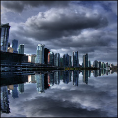 Obsidian (ecstaticist) Tags: ocean cloud canada west reflection glass rain skyline vancouver skyscraper photoshop dark harbor marine downtown bc flood cloudy ripple smooth simulation landing casio condo commute otter end boardwalk coal soe westend coalharbor dehavilland photomatix exf1 flotplane youhavediscoverthesecretlol