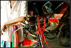 The Driver of Joy Ride [..Dhaka, Bangladesh..] (Catch the dream) Tags: colors tricycle garage traditional bongo vehicles shade driver dhaka tradition rickshaw arrangement bengal bangladesh bangla ecofriendly bengali bangladeshi bangali rickshawdriver dhakacity colorfulride withoutpollution colorfulvehicle traditionalride gettyimagesbangladeshq2