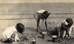 Busy on the beach (lovedaylemon) Tags: 1920s sea holiday beach girl vintage found seaside bucket sand image sandcastle spade hairribbon