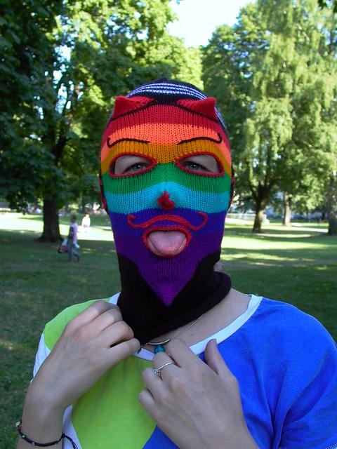 masked criminal shows tongue