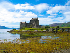 Eilean Donan Castle in Scotland (Shadowgate) Tags: bridge sky lake green castle castles clouds scotland highlands lakes creativecommons loch eilean donan flickrsbest anawesomeshot