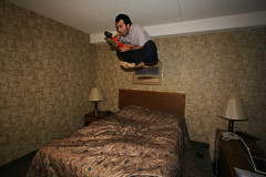 pizza on the go (scienceduck) Tags: 15fav selfportrait ontario canada me public june 510fav hotel jump bed eating motel moi pizza 2008 bedjumping fortfrances scienceduck bedjump