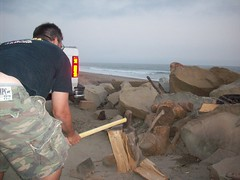 chopping wood. (adrianna.) Tags: wood camping beach fire dad choppingwood
