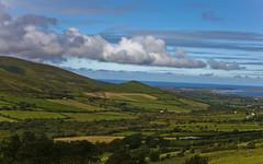 (clyatt.jasper) Tags: ireland sea sky green grass clouds countryside hills farms
