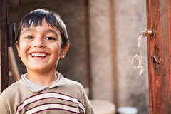 Iranian boy (damonlynch) Tags: door boy smile happy persian key village iran muslim joy doorway laugh iranian pesar mojen semnanprovince upcoming:event=916887