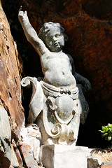 Stone Cherub (Icy Sedgwick) Tags: statue wales cherub portmeirion
