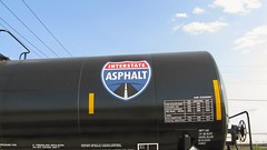 Shiny, brand new Interstate Asphalt tank car. The Canadian National ex Illinois Central Crawford Yard. Chicago Illinois. June 2008.