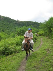 Dave hitching a ride (tbchinte) Tags: horse lake volcano philippines crater laketaal volcaniclake