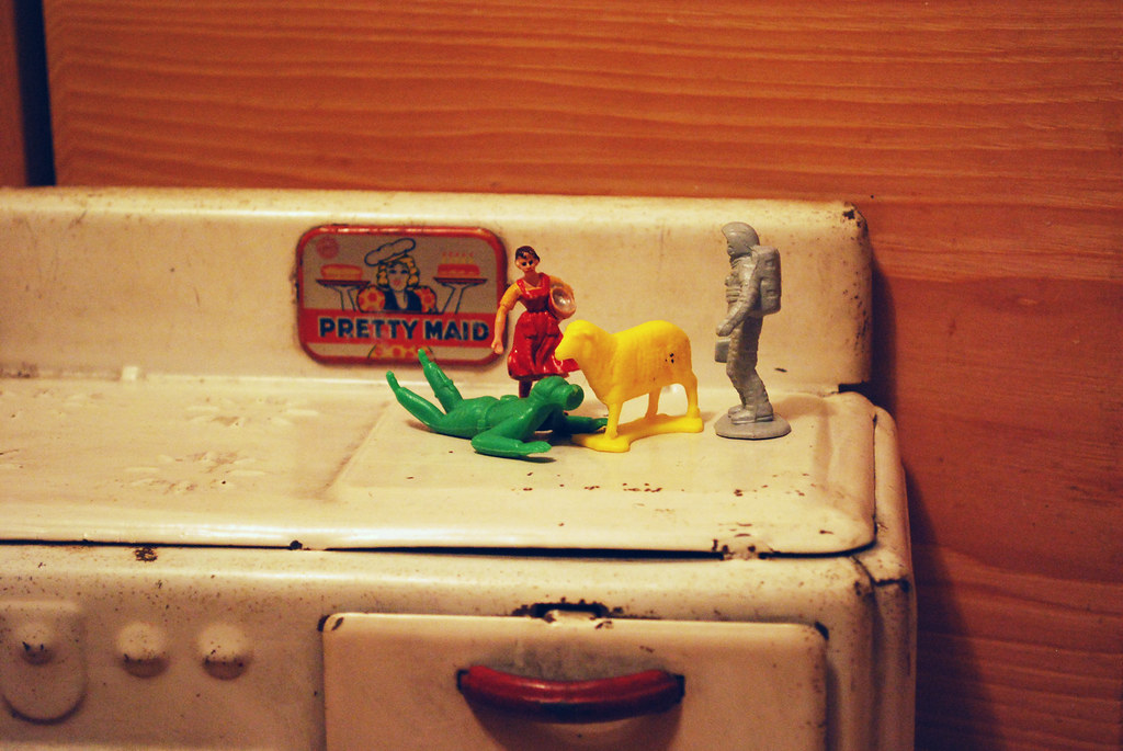 plastic figures on stovetop