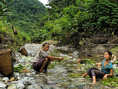 Poverty is a state of mind (Bn) Tags: forestry laos vangvieng motheranddaughter hmongpeople mongpeople cascadingriver waistdeepwater asianethicgroup supportthemselves povertyisastateofmind khancave smallvegetablegardens swiftstreams infrequentvisitors mountainousregions