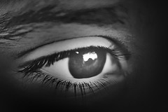 (Sanctuary photography  back ! maybe :p) Tags: light bw macro reflection eye closeup eyes nikon focus dof sad eyeball seeing eyelash rashid d300