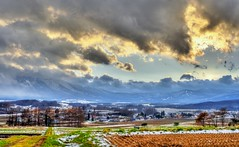 Moody Hachimantai after a Storm (jasohill) Tags: city autumn winter sky cloud storm mountains fall nature colors japan canon landscape photography eos 350d japanese landscapes moody rice best iwate canon350d backgrounds fields  after 2008   tohoku hdr matsuo jasonhill touhoku hachimantai  canonef70200mmf28lusm  fotocompetition fotocompetitionbronze
