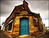 The blue door (Manlio Castagna) Tags: sky scotland bravo sigma chapeau 1020mm cromarty hdr manlio castagna photomatix tonemapped manliocastagna manliok