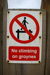 No climbing on groynes (ludwig van standard lamp) Tags: funny creativecommons filth groyne southwold pun punny walbeswick southwoldsojourn