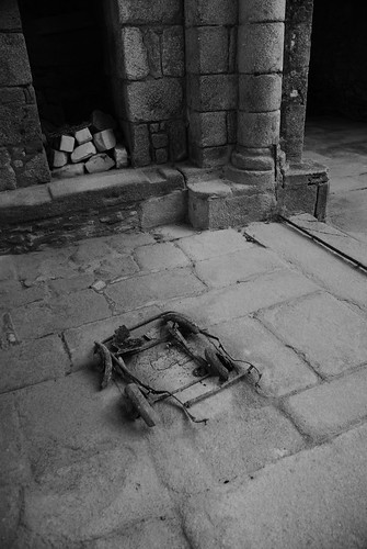 The remains of a pram lie in the church at Oradour sur Glane