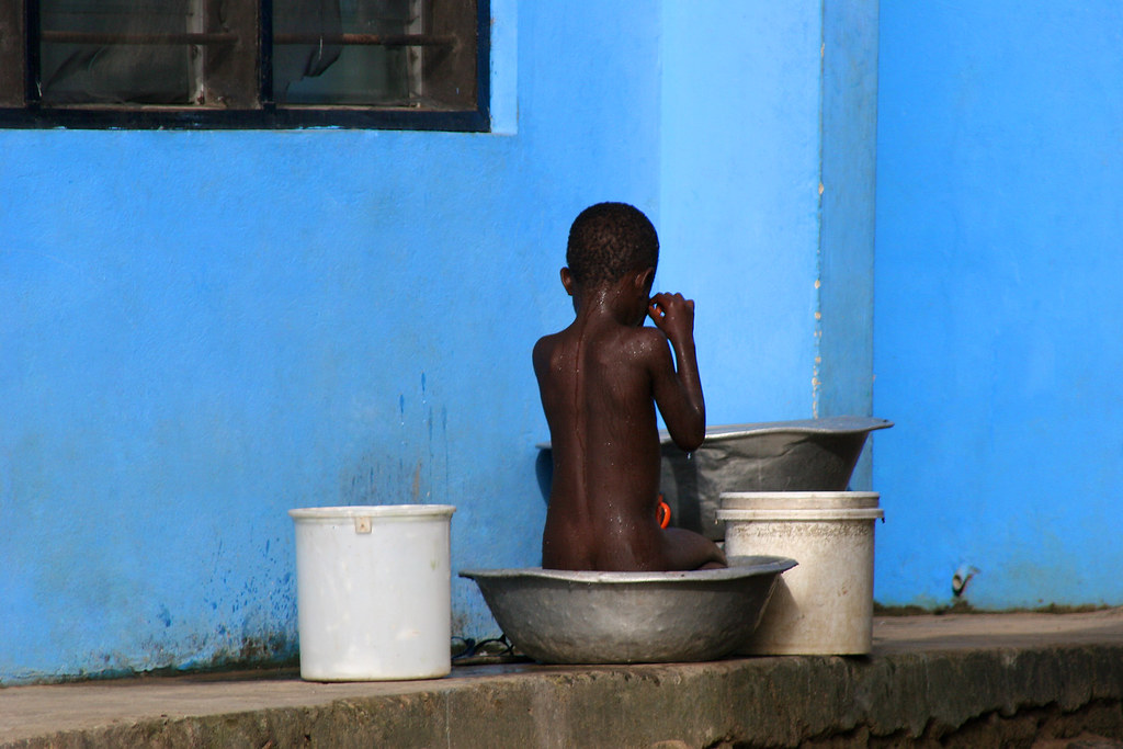 Boy and the blue wall - Ghana