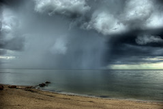 Distant Rain (bryanscott) Tags: lake storm beach rain clouds winnipeg manitoba hdr gimli