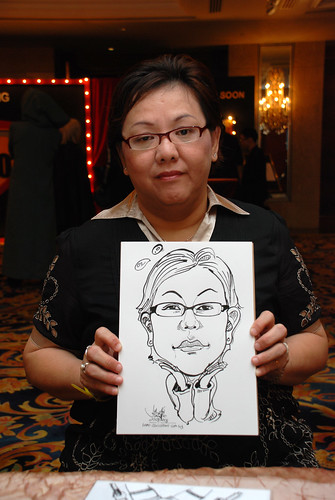 Caricature live sketching for Temasek Holdings D&D 2008 Hero Night 7