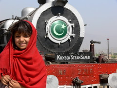Khyber Pass Welcome (openyourap) Tags: old railroad travel pakistan afghanistan girl beautiful beauty smile face look station smiling metal female scarf train vintage hair happy clothing iron pretty track child little steel traditional transport tracks rail railway fringe steam clothes safari fabric transportation rails peshawar locomotive pakistani shawl nwfp khyber northwestfrontierprovince dupatta 5photosaday landikotal