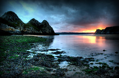 Sunset at Three Cliffs Bay (2) (-terry-) Tags: sunset sky cloud sun reflection swansea wales rocks flickr dusk explore thumbsup threecliffsbay flickrexplore thegower seeninexplore aplusphoto