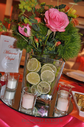 Table centerpieces by Diamond Events with limes