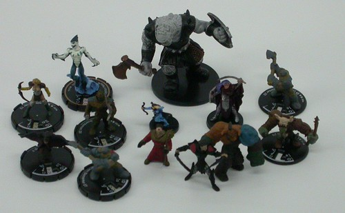 Nine Mage Knight figures, of which two have been removed from the clicky part of their bases and three have been removed from their bases entirely; a Heroclix mini; Large, Medium, and Small D&D minis