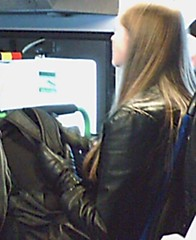 070216_155156 (RistoH) Tags: cameraphone winter black bus guy leather finland helsinki sitting candid longhair trenchcoat