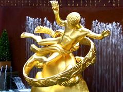 Symbolic (jglsongs) Tags: nyc newyorkcity sculpture newyork fountain statue architecture buildings gold manhattan rockefellercenter landmark structure midtown artdeco rockefeller nuevayork prometheus rockefellerplaza                thnhphnewyork      newyorkstadt