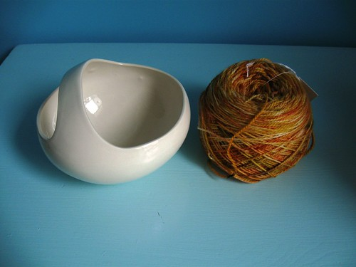 Ceramic basket and sock yarn.