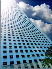 Reaching Into The Blue (rcvernors) Tags: blue windows sky building art window clouds skyscraper photoshop lens digitalart surreal computerart flare tall thumbsup aw allrightsreserved photoshopart bigmomma allrightsreserved rcvernors altereduniverse thechallengefactory