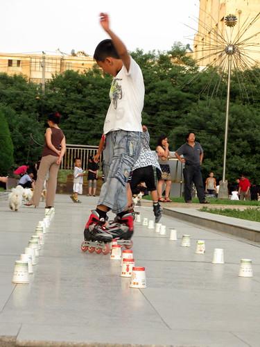 Children skating in a square in Jiuquan, Gansu Province, China