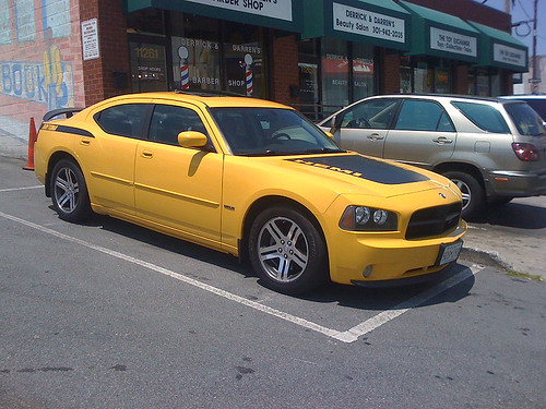 A yellow Dodge Charger Daytona - Taken With An iPhone