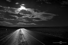 Slippery road at night. (Jokull) Tags: road longexposure winter shadow sky bw moon white mountain black mountains cold ice night clouds canon reflections dark stars island star photo iceland interestingness highlands cool frost december shadows darkness nightshot natural details country dramatic highcontrast 2006 monochromatic photograph midnight moonlight traveling icy kalt reflexions coolest slippery sland auroraborealis nightpicture distant darksky icelandic vetur frosen himinn naturesfinest speglun jokull fjall supershot 1740mmf4 fallegt svhv vesturland canoneos40d canon40d traveltoiceland plljkull nturmyndataka palljokull dkkur cometoiceland