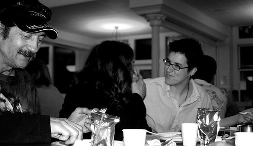 Pastor Megan eats and chats with guests at the Welcome Ministry Community Dinner