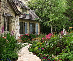The Fairytale Cottages of Carmel (linda yvonne) Tags: stone garden colorful path cottage blues shutters oranges yellows pinks delightful carmelbythesea stonepath cottagegarden interestingness3 i500 storybookstyle storybookhomes lindayvonne whimsicalhomes