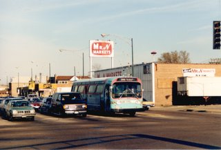 Westbound pre Pace Suburban Transit bus in the southbound turning lane at South Archer and Harlem Avenues. Chicago Illinois. April 1988.