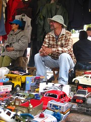 Guy selling old toy trucks at black market
