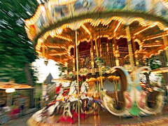 Furious (Sator Arepo) Tags: park leica carnival summer horses motion amusement reflex movement bravo energy power fairground action roundabout carousel fair amusementpark dizzy frantic emergency merrygoround zuiko carcassonne furious giddy tiovivo zooming digilux firstquality 714mm digilux3 zd714mm visiongroup vision100 retofez100914
