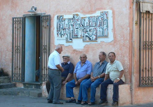 Old men chat in the square