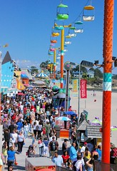 People On The Boardwalk (cwgoodroe) Tags: california carnival blue wedding summer santacruz sun color beach water sand surf candy games boardwalk rollercoaster