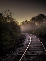 In The Curve (evanleavitt) Tags: county railroad morning cold tower water fog train sunrise ga ties georgia tracks atmosphere rr olympus rails curve hdr clarke e510 photomatix