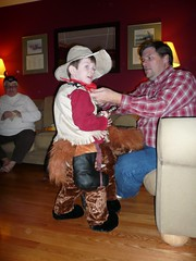 Trying On His Halloween Costume (DNAMichaud) Tags: halloween cowboy halloweencostume geoffrey