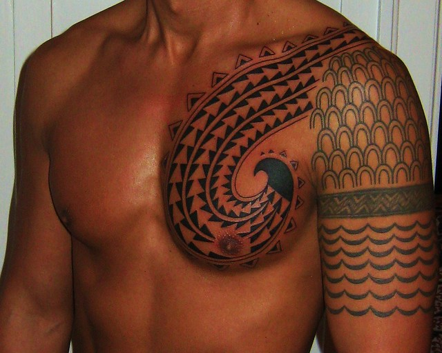 Hawaiian Chest Tattoo-- spears and shark teeth in fish hook pattern designed