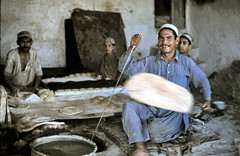 gm_03110 Nan Bakery in Herat, Afghanistan 1975 (CanadaGood) Tags: blue people white afghanistan color colour analog shopping bread person asia slidefilm bakery afghan 1975 kodachrome seventies herat canadagood slidecube
