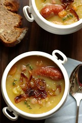 Old-fashioned cozyness (Thorsten (TK)) Tags: wood food brown comfortable bread soup stew traditional rustic onions potato sausages carrots suppe roasted foodphotography wrstchen foodpresentation kartoffelsuppe foodstyling thorstenkraska