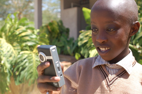 Kenyan schoolboy using a Flip camera